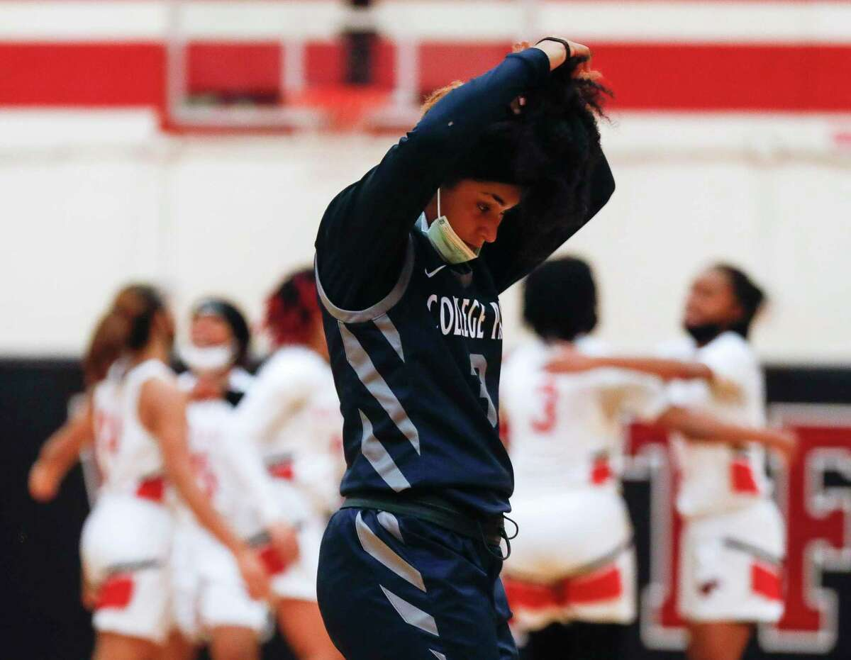 College Park point guard Treasure Harrison (3) wraps up her hair after the team's 51-46 double-overtime loss to Westfield in a Region II-6A high school bi-district playoff game at Westfield High School, Saturday, Feb. 13, 2021, in Spring.