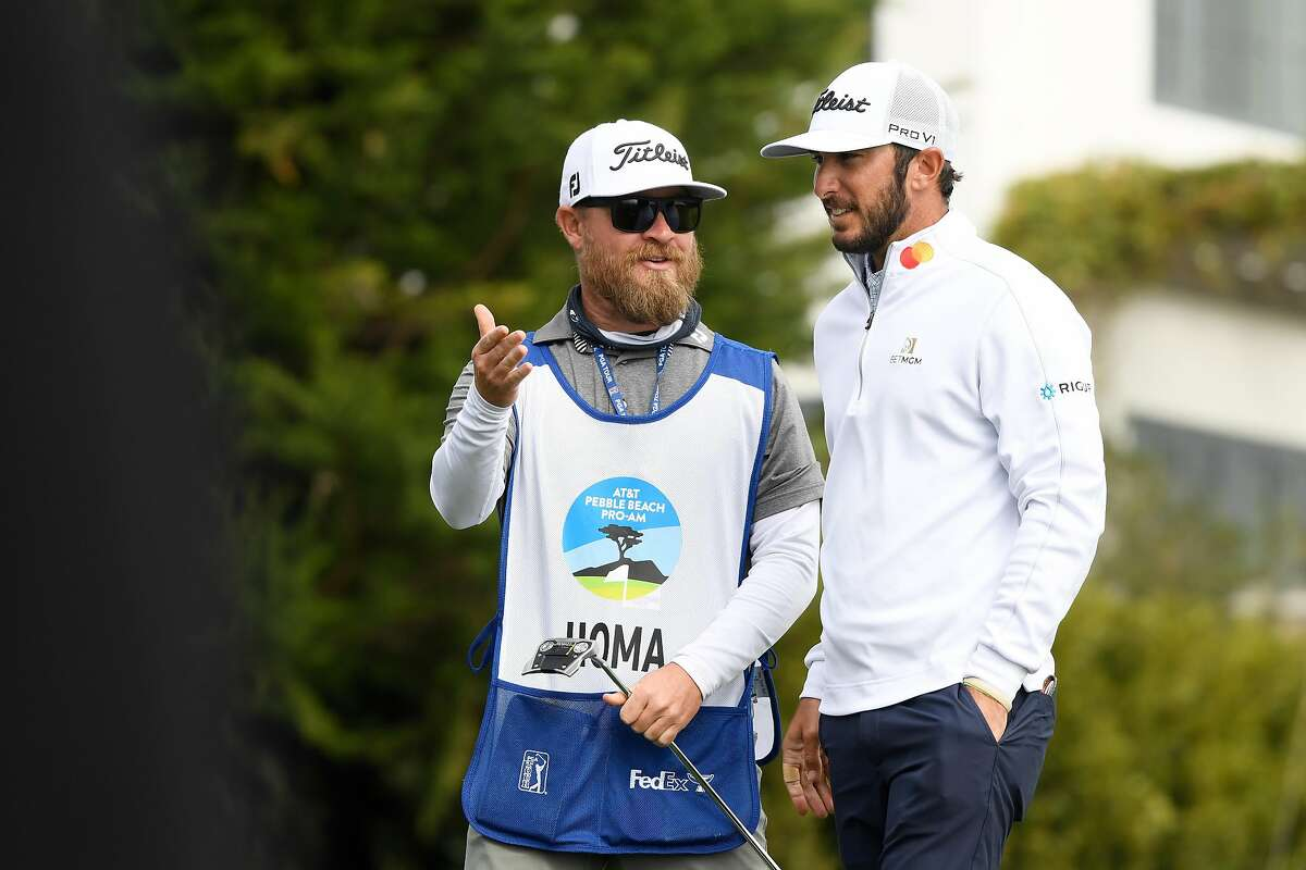 Cal alum Max Homa talks with his caddie Friday at Pebble Beach. Homa made birdie on all four of Pebble's par-3s in his 68 on Saturday.