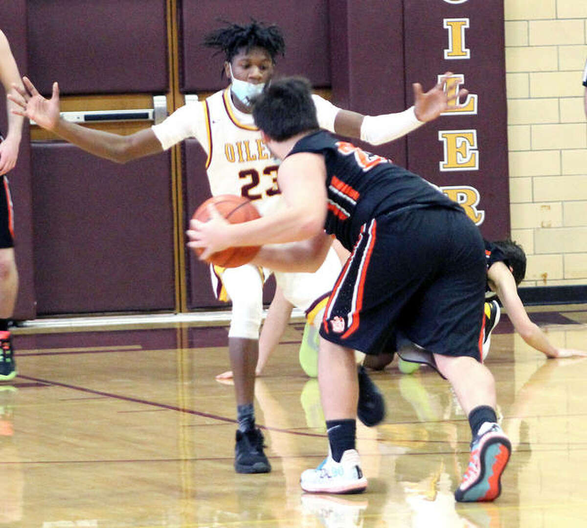 Antonio Hardin of EA-WR (23) guards Gillespie's Zane Cunningham Saturday during their game in Wood River.