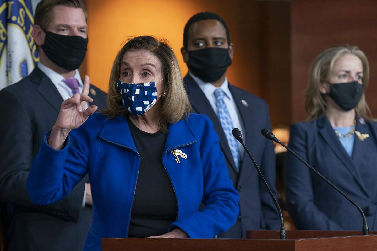 House Speaker Nancy Pelosi, flanked by impeachment managers Rep. Eric Swalwell, D-Dublin., Rep. Madeleine Dean, D-Pa., and Rep. Joe Neguse, D-Colo., speaks to members of the media during a news conference on Capitol Hill in Washington, after the U.S. Senate voted to acquit former President Donald Trump of inciting riot at U.S. Capitol, ending the impeachment trial.