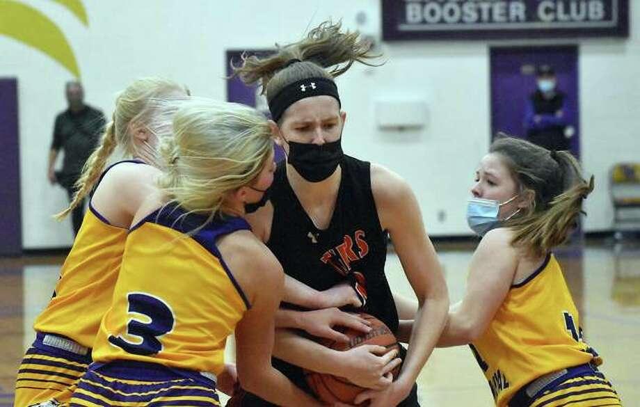 Edwardsville senior center Katelynne Roberts fights off three Civic Memorial players for a rebound on Saturday in Bethalto. Photo: Matt Kamp|The Intelligencer