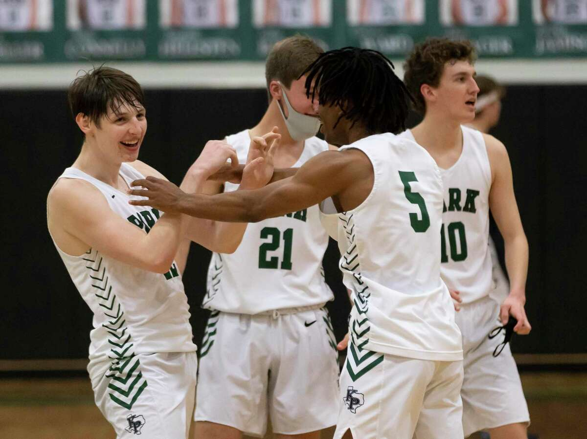 Kingwood Park basketball team react after they win against Lake Creek in a District 20-5A boys basketball game at Kingwood Park High School, Wednesday, Jan. 27, 2021 in Kingwood.