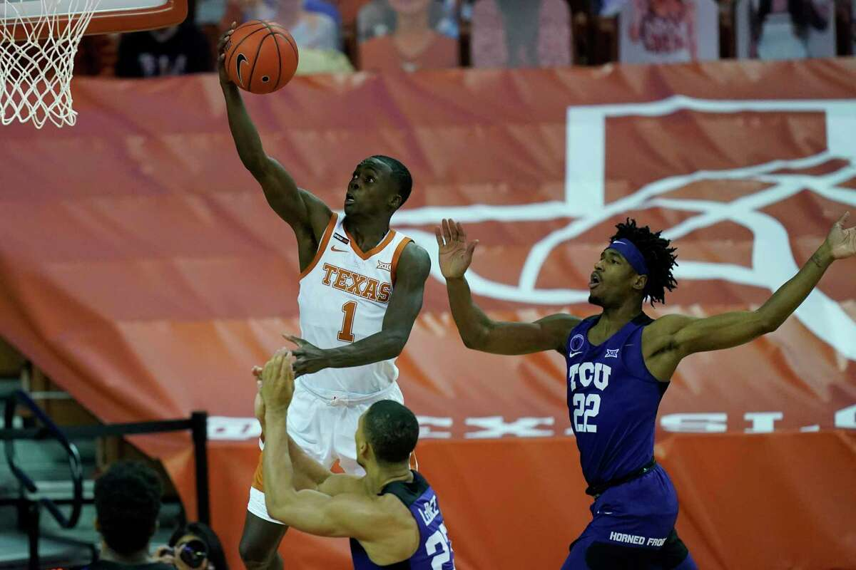 Texas guard Andrew Jones (1) drives to the basket past TCU guard RJ Nembhard (22) during the second half of an NCAA college basketball game, Saturday, Feb. 13, 2021, in Austin, Texas. (AP Photo/Eric Gay)