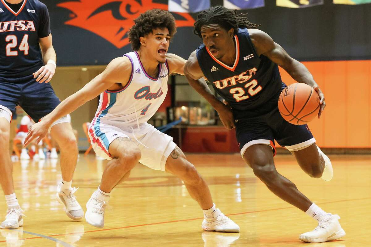 UTSA's Keaton Wallace, right, drives past Florida Atlantic's BJ Greene during the second half of their Men's Conference USA basketball game with Florida Atlantic at the Convocation Center on Saturday, Feb. 13, 2021. UTSA beat the Owls 86-75.