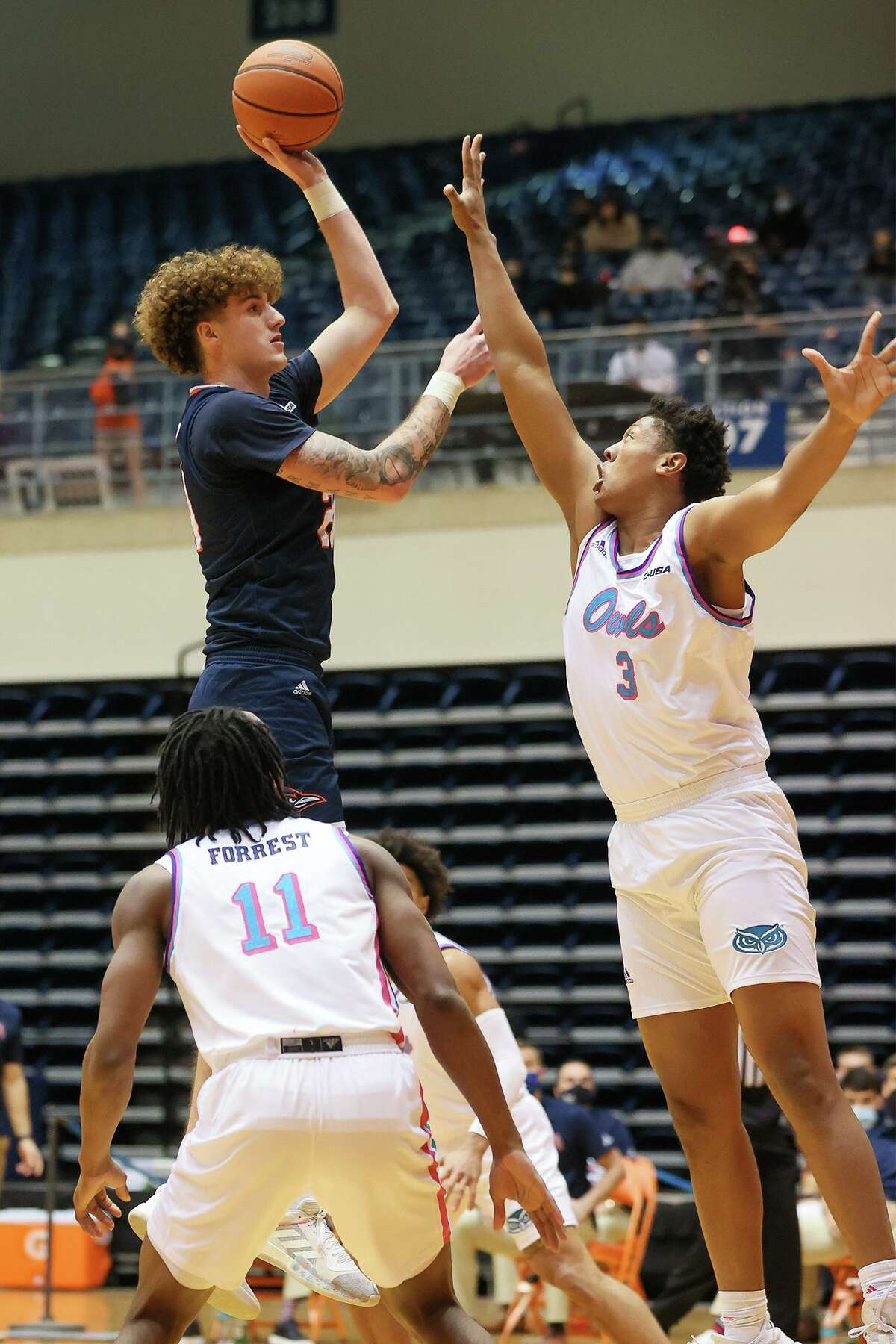 UTSA's Jacob Germany shoots over Florida Atlantic's Giancarlo Rosado during the first half of their Men's Conference USA basketball game at the Convocation Center on Saturday, Feb. 13, 2021. UTSA beat the Owls 86-75.