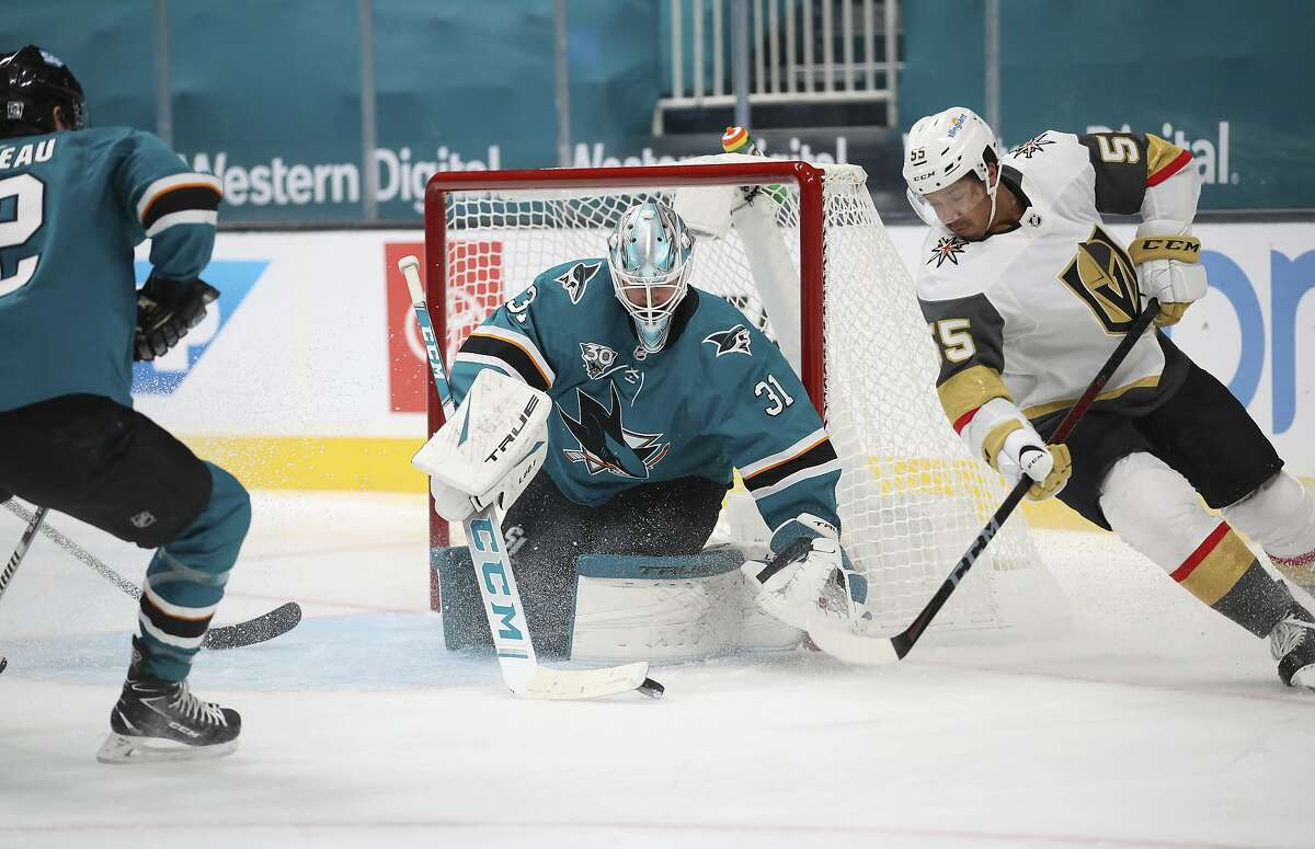 Sharks goalie Martin Jones makes a save against Vegas right wing Keegan Kolesar in the second period.