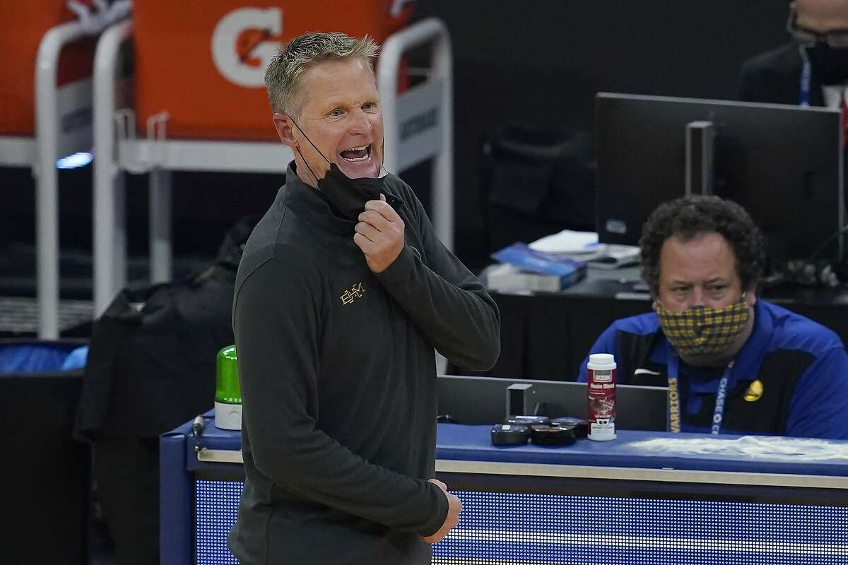 Golden State Warriors head coach Steve Kerr reacts during the first half of an NBA basketball game against the Orlando Magic in San Francisco, Thursday, Feb. 11, 2021. (AP Photo/Jeff Chiu)