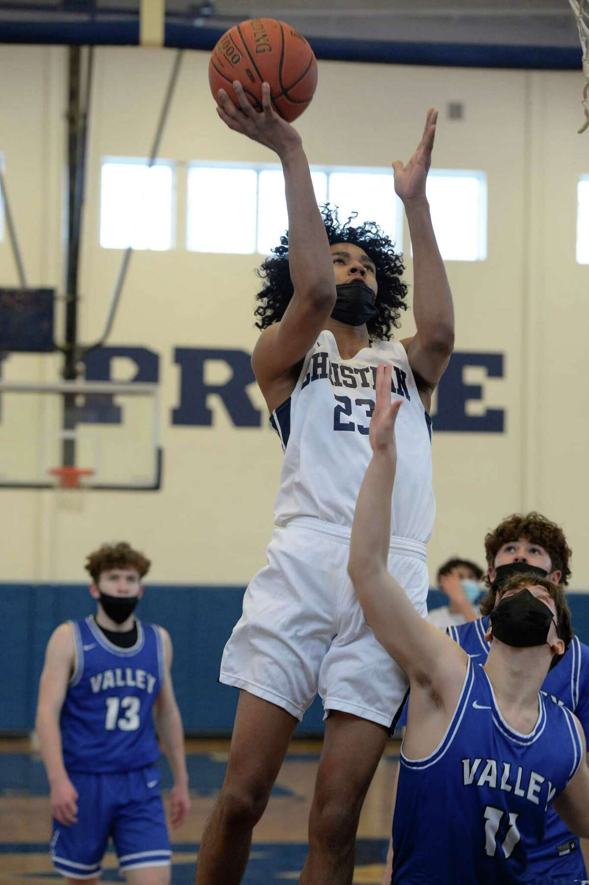Topped all scorers with 34 points in the Lions' 78-53 win against Bishop Maginn. Here, he takes a shot over Hoosic Valley's Lane Carner during a game on Saturday, Feb. 13, 2021.