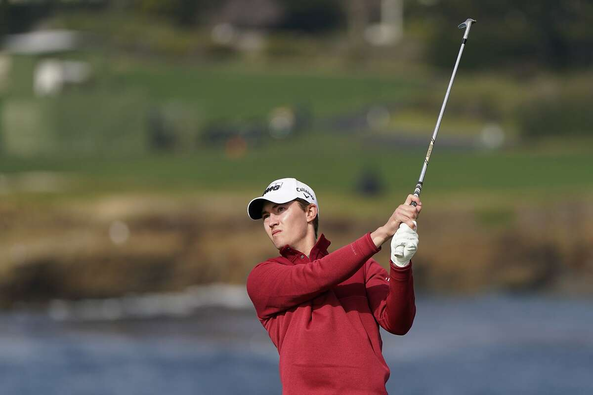 Maverick McNealy follows his shot from the No. 7 tee at Pebble Beach during Saturday's third round of the AT&T Pro-Am. McNealy shot 69 and will begin play Sunday three strokes off the lead.