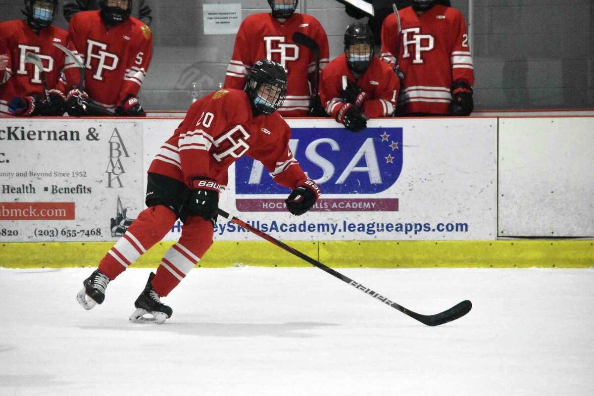 Fairfield Prep's Tiernan Curley skates up the ice against Darien at the Darien Ice House on Saturday.