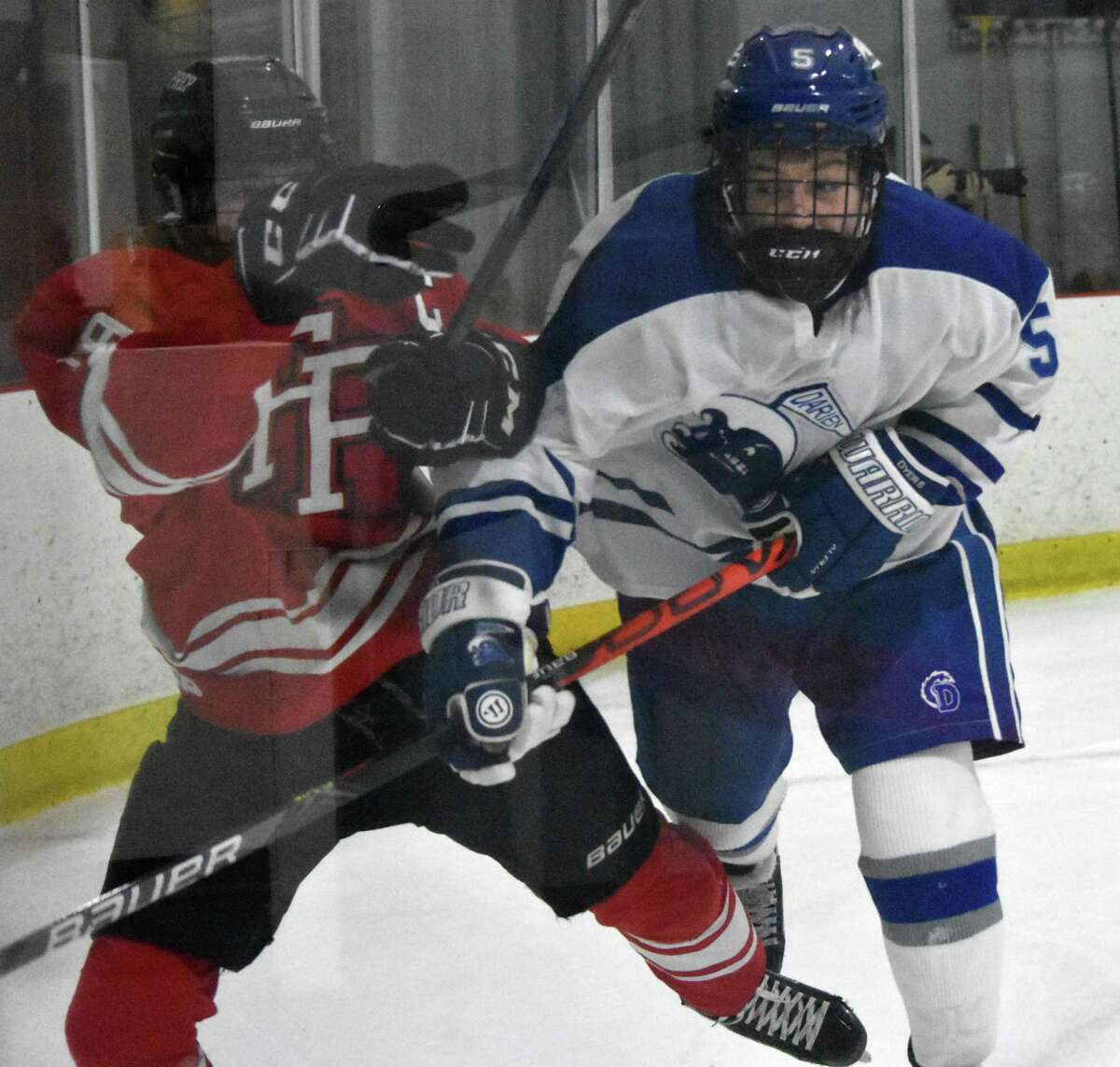 Action between Fairfield Prep and Darien hockey at the Darien Ice House on Saturday.