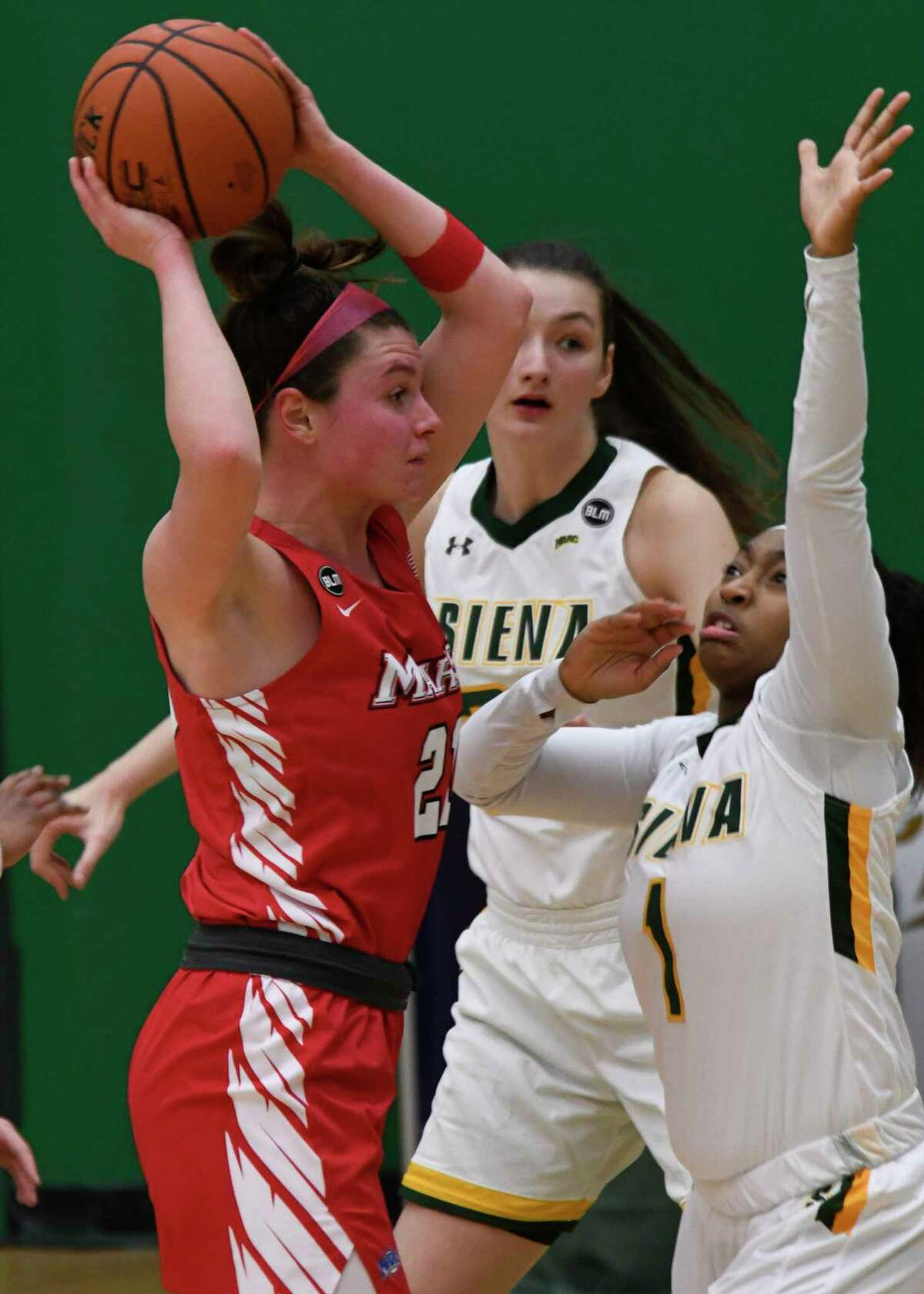 Siena's Ahniysha Jackson guards Marist's Willow Duffell during a game on Saturday, Feb. 13, 2021, in Loudonville, N.Y.