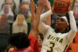 Siena's Rayshel Brown takes a shot over the hands of Marist's Trinasia Kennedy during a game on Saturday, Feb. 13, 2021, in Loudonville, N.Y.