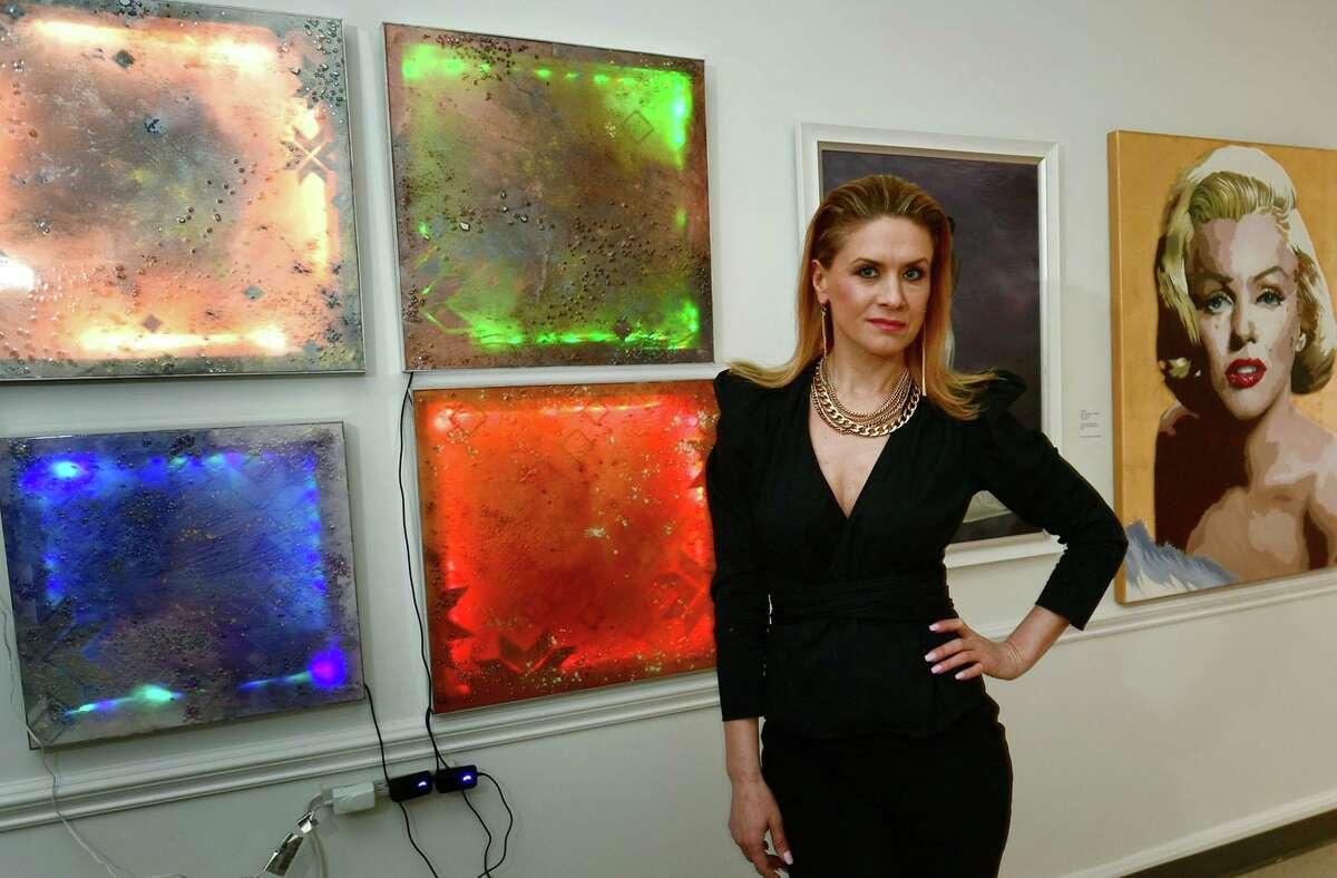 Oksana Tanasiv stands by her work, Light Installation Code, at her new contemporary art studio, Oksana Tanasiv Gallery, in Norwalk on Saturday.