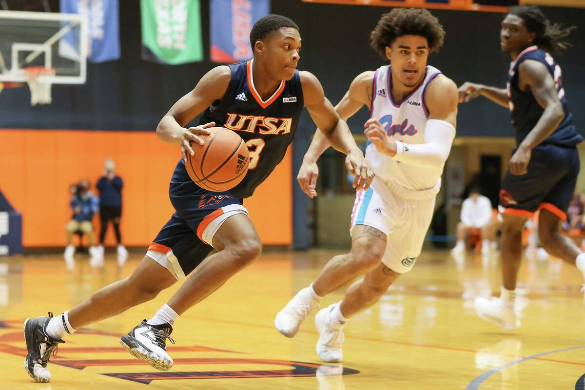 UTSA's Jordan Ivy-Curry, left, drives the ball against Florida Atlantic's BJ Greenlee during the first half of their Men's Conference USA basketball game at the Convocation Center on Saturday, Feb. 13, 2021. UTSA beat FAU 86-75.