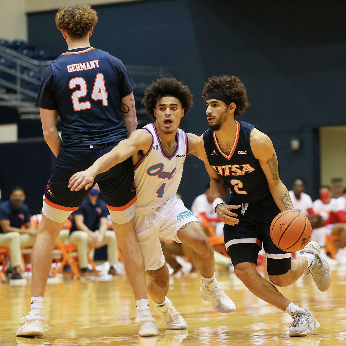 UTSA's Jhivvan Jackson, right, drives by Florida Atlantic's BJ Greenlee as Jacob Germany sets a pick during the second half of their Men's Conference USA basketball game at the Convocation Center on Saturday, Feb. 13, 2021. UTSA beat the Owls 86-75.