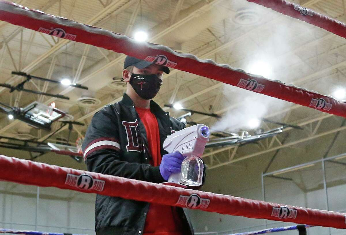 Between matches the arena is sanitized. Golden Gloves matches at George Gervin Wellness Center on Saturday, Feb. 13,2021.