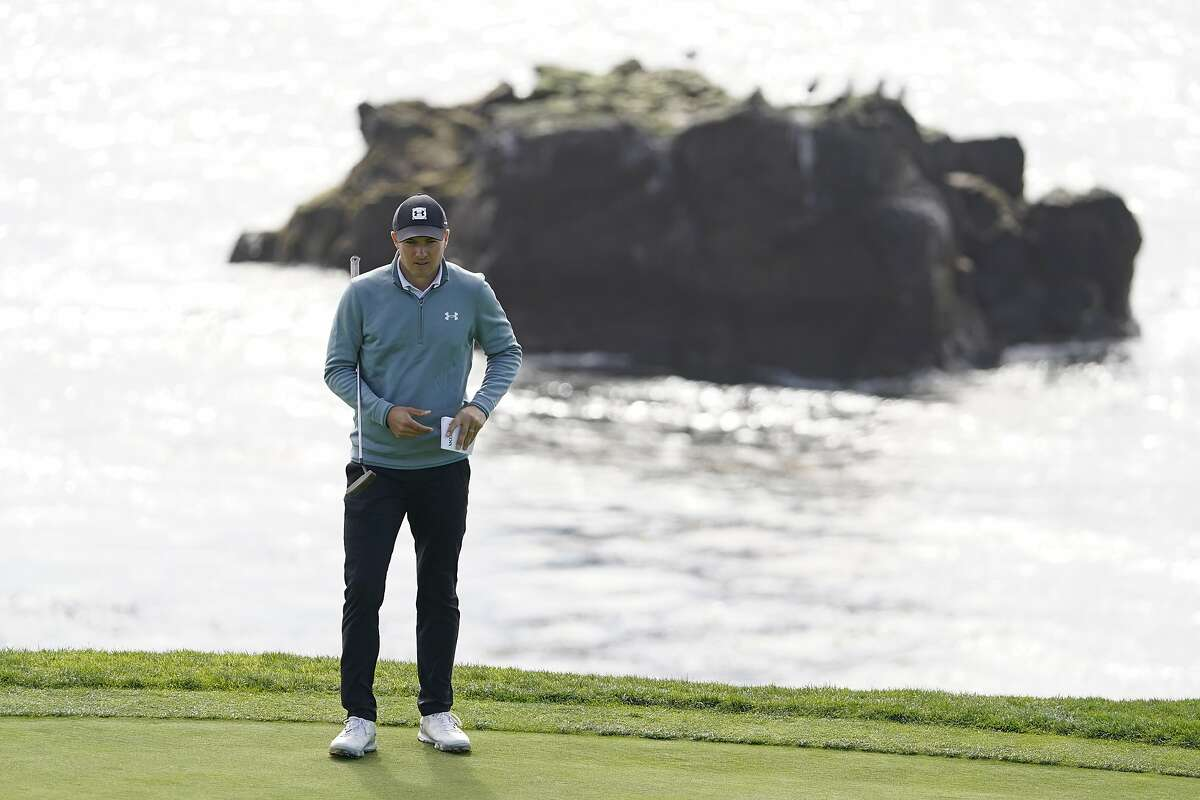 Jordan Spieth reads the eighth green of the Pebble Beach Golf Links during the third round of the AT&T Pebble Beach Pro-Am golf tournament Saturday, Feb. 13, 2021, in Pebble Beach, Calif. (AP Photo/Eric Risberg)