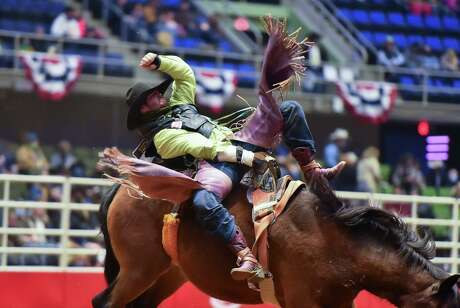 A rider bounces on his mount during the opening night of the San Antonio Stock Show and Rodeo at the Freeman Coliseum.