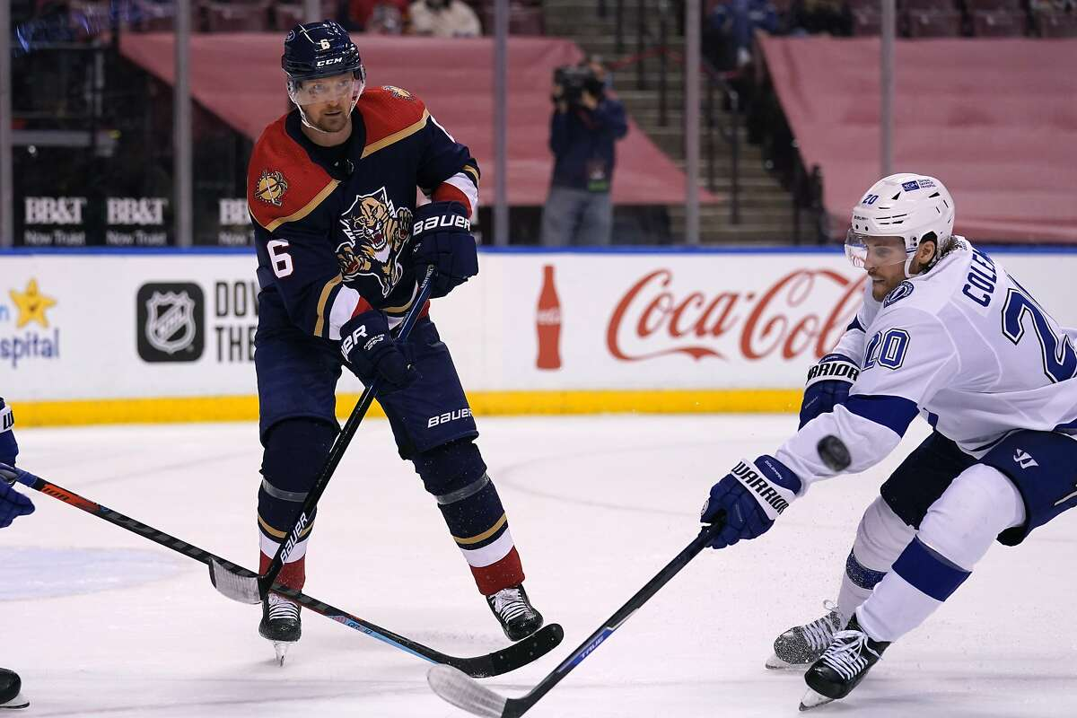 Tampa Bay Lightning center Blake Coleman (20) and Florida Panthers defenseman Anton Stralman (6) go for the puck during the third period of an NHL hockey game, Saturday, Feb. 13, 2021, in Sunrise, Fla. (AP Photo/Lynne Sladky)