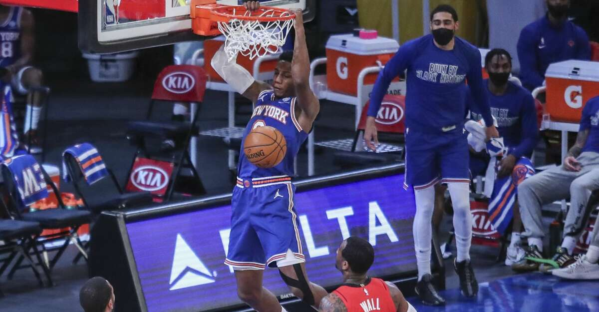 New York Knicks guard RJ Barrett dunks next to Houston Rockets' John Wall (1) during the second quarter of an NBA basketball game Saturday, Feb. 13, 2021, in New York. (Wendell Cruz/Pool Photo via AP)