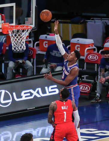 New York Knicks guard RJ Barrett (9) shoots over Houston Rockets guard John Wall (1) during the first quarter of an NBA basketball game Saturday, Feb. 13, 2021, in New York. (Wendell Cruz/Pool Photo via AP) Photo: Wendell Cruz/Associated Press / Wendell Cruz