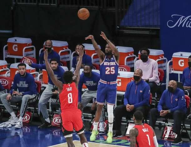 New York Knicks forward Reggie Bullock (25) shoots against the Houston Rockets during the first quarter of an NBA basketball game Saturday, Feb. 13, 2021, in New York. (Wendell Cruz/Pool Photo via AP) Photo: Wendell Cruz/Associated Press / Wendell Cruz