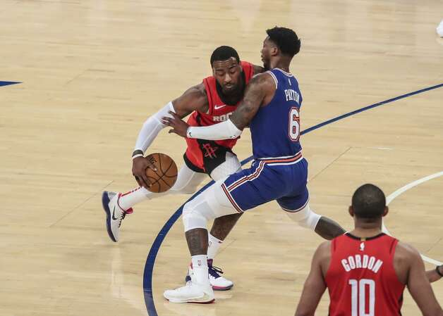 Houston Rockets guard John Wall (1) drives against New York Knicks guard Elfrid Payton (6) during the first quarter of an NBA basketball game Saturday, Feb. 13, 2021, in New York. (Wendell Cruz/Pool Photo via AP) Photo: Wendell Cruz/Associated Press / Wendell Cruz