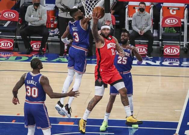 Houston Rockets center DeMarcus Cousins (15) shoots a reverse layup against the New York Knicks during the first quarter of an NBA basketball game Saturday, Feb. 13, 2021, in New York. (Wendell Cruz/Pool Photo via AP) Photo: Wendell Cruz/Associated Press / Wendell Cruz