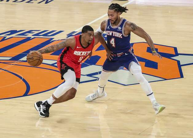 Houston Rockets guard Mason Jones (9) drives against New York Knicks guard Derrick Rose (4) during the second quarter of an NBA basketball game Saturday, Feb. 13, 2021, in New York. (Wendell Cruz/Pool Photo via AP) Photo: Wendell Cruz/Associated Press / Wendell Cruz