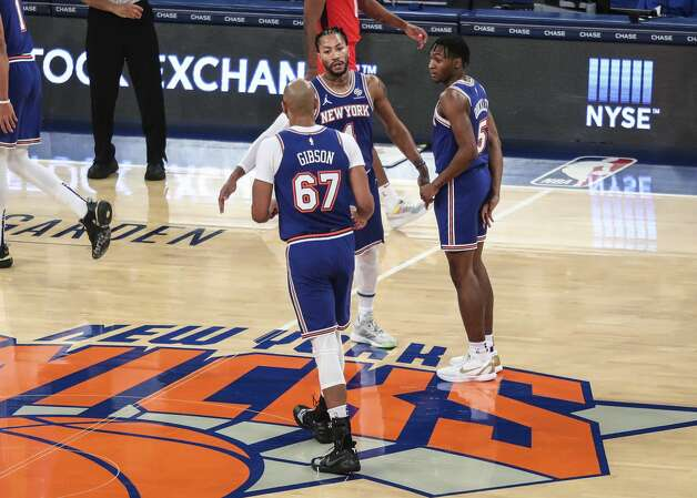 New York Knicks guard Derrick Rose, rear, is greeted by center Taj Gibson (67) and guard Immanuel Quickley (5) during a timeout in the second quarter against the Houston Rockets in an NBA basketball game Saturday, Feb. 13, 2021, in New York. (Wendell Cruz/Pool Photo via AP) Photo: Wendell Cruz/Associated Press / Wendell Cruz