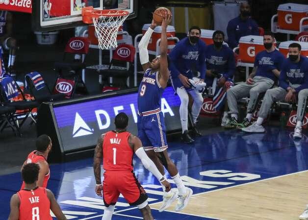 New York Knicks guard RJ Barrett (9) dunks against the Houston Rockets during the second quarter of an NBA basketball game Saturday, Feb. 13, 2021, in New York. (Wendell Cruz/Pool Photo via AP) Photo: Wendell Cruz/Associated Press / Wendell Cruz