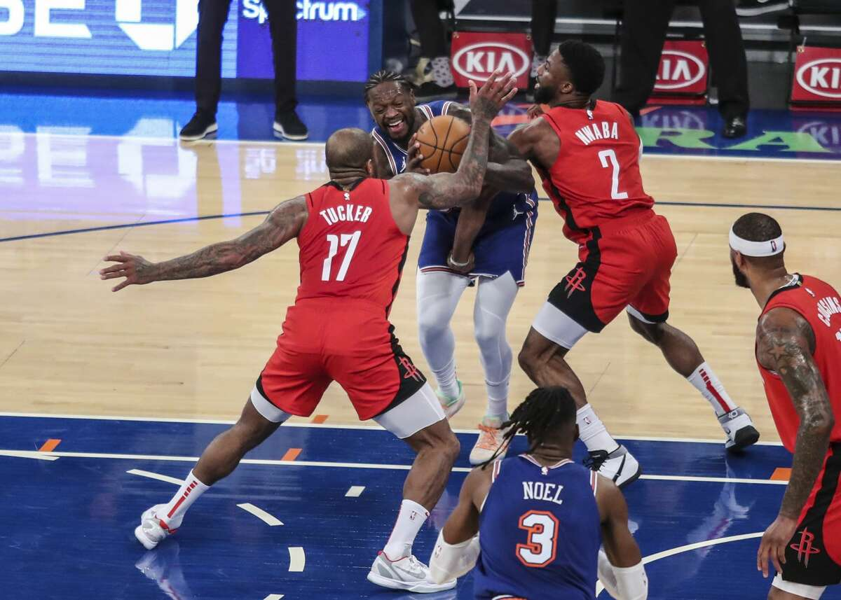 New York Knicks forward Julius Randle, middle, is double-teamed by Houston Rockets forward P.J. Tucker (17) and guard David Nwaba (2) during the third quarter of an NBA basketball game Saturday, Feb. 13, 2021, in New York. (Wendell Cruz/Pool Photo via AP)