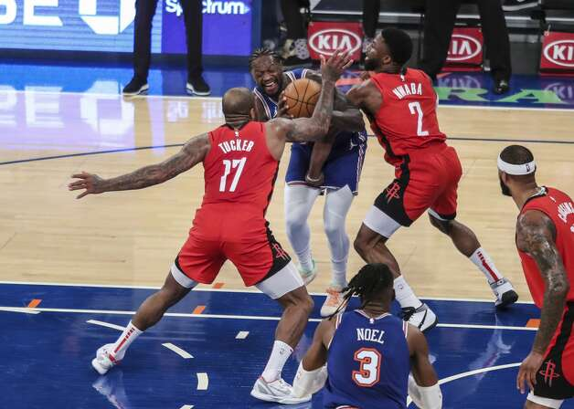 New York Knicks forward Julius Randle, middle, is double-teamed by Houston Rockets forward P.J. Tucker (17) and guard David Nwaba (2) during the third quarter of an NBA basketball game Saturday, Feb. 13, 2021, in New York. (Wendell Cruz/Pool Photo via AP) Photo: Wendell Cruz/Associated Press / Wendell Cruz