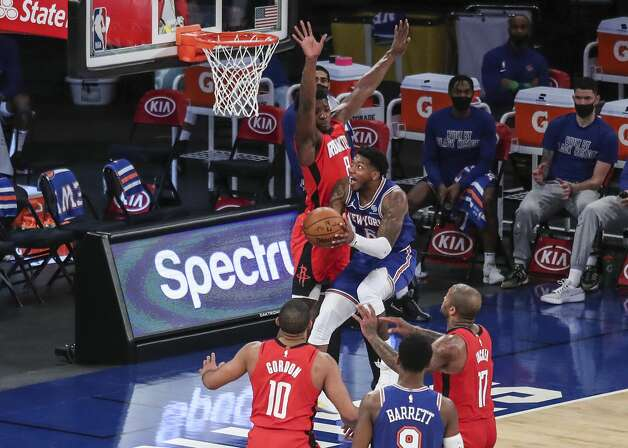 New York Knicks guard Elfrid Payton (6) drives in for a layup against the Houston Rockets during the second quarter of an NBA basketball game Saturday, Feb. 13, 2021, in New York. (Wendell Cruz/Pool Photo via AP) Photo: Wendell Cruz/Associated Press / Wendell Cruz