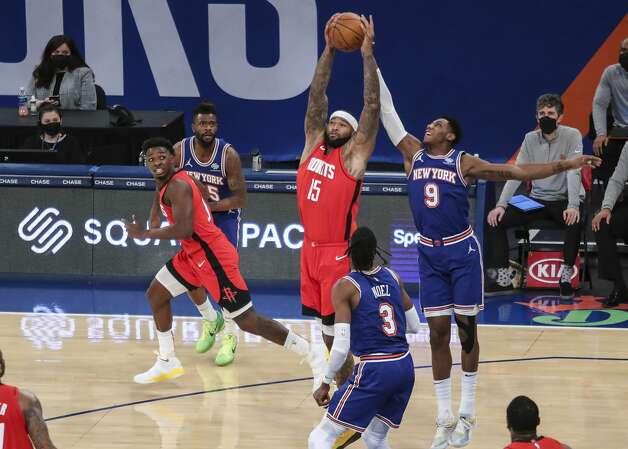 Houston Rockets center DeMarcus Cousins (15) and New York Knicks guard RJ Barrett (9) reach for a rebound during the third quarter of an NBA basketball game Saturday, Feb. 13, 2021, in New York. (Wendell Cruz/Pool Photo via AP) Photo: Wendell Cruz/Associated Press / Wendell Cruz