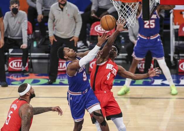 New York Knicks guard RJ Barrett (9) shoots over Houston Rockets forward Danuel House Jr. (4) during the fourth quarter of an NBA basketball game Saturday, Feb. 13, 2021, in New York. (Wendell Cruz/Pool Photo via AP) Photo: Wendell Cruz/Associated Press / Wendell Cruz