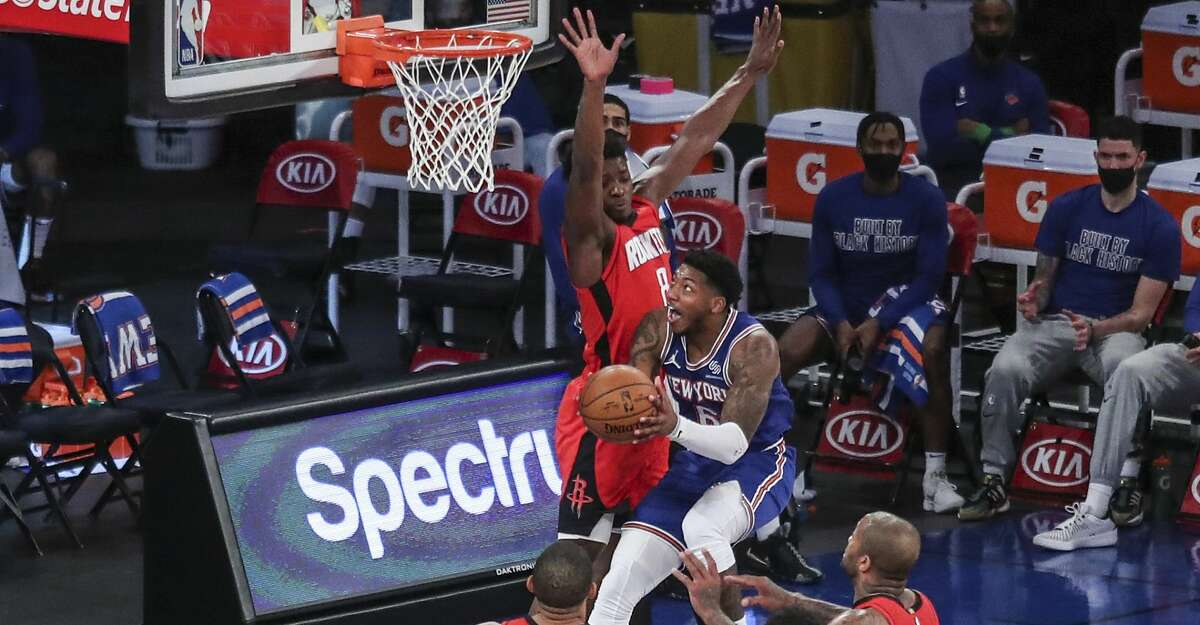 New York Knicks guard Elfrid Payton (6) drives in for a layup against the Houston Rockets during the second quarter of an NBA basketball game Saturday, Feb. 13, 2021, in New York. (Wendell Cruz/Pool Photo via AP)