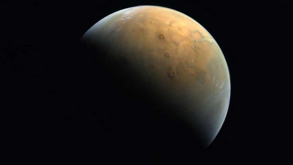 The first image of Mars snapped by the Al Amal, or Hope, spacecraft. The photo was captured at a distance of 15,500 miles from the planet's surface.