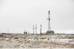 Oil rigs are seen in a icy landscape near Interstate 20 in Odessa. The winter storm cut oil and gas production significantly.