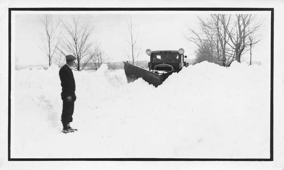 Trying to break through a packed drift with the double wing diesel plow truck, circa 1930s. (Courtesy Photo)