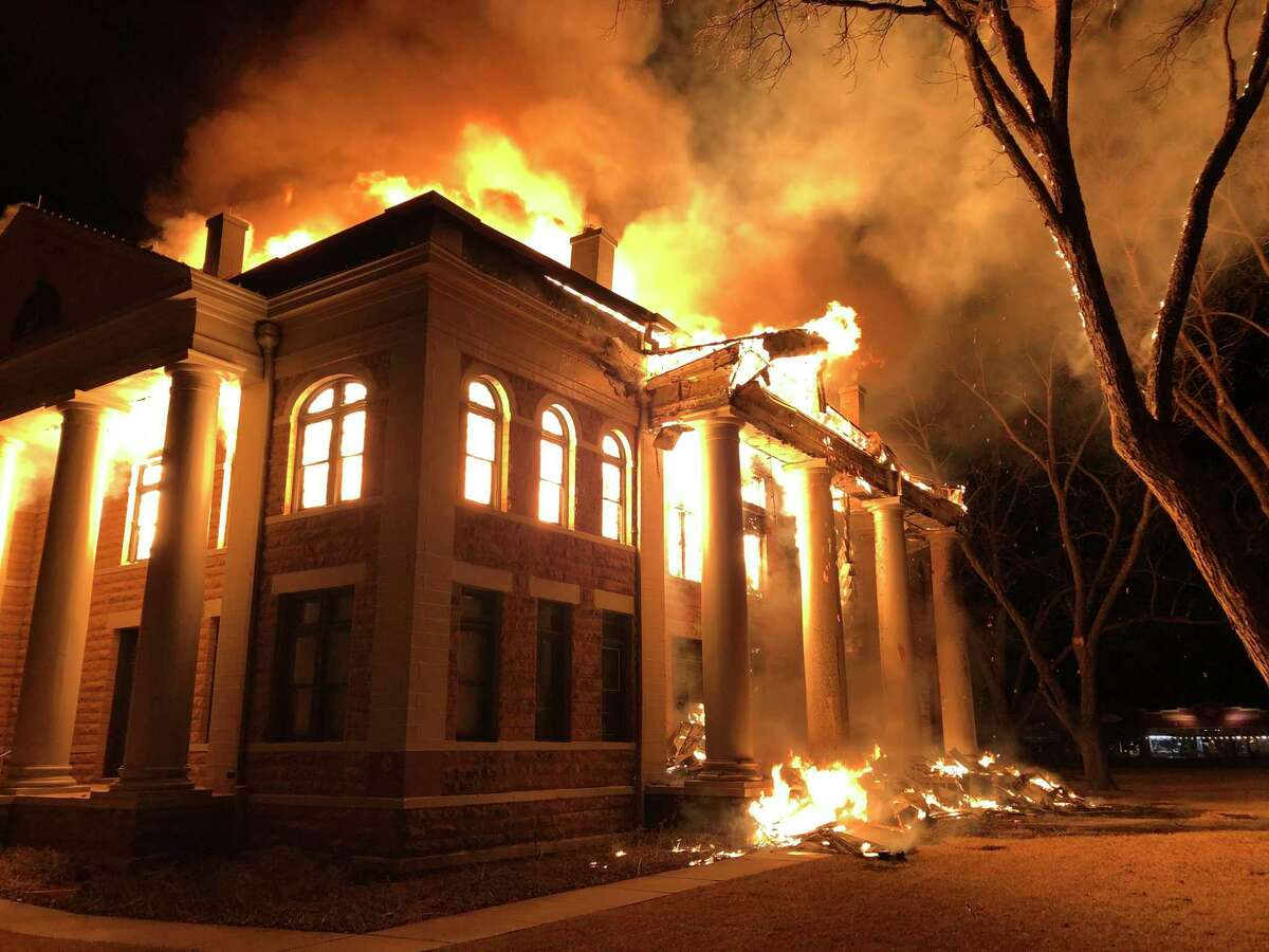 This photo provided by Mason County Judge Jerry Bearden shows a fire at the Mason County Courthouse on Feb. 4, 2021, in Mason. An official says a suspect has been taken into custody following the massive fire that destroyed all but the rock outer walls of the 111-year-old courthouse. Fire investigators suspect arson in both the courthouse fire and a fire around the same time at a house about a mile away.