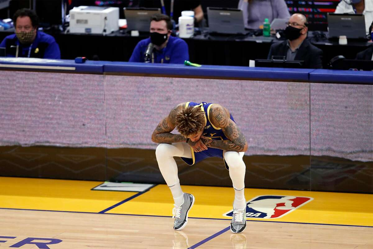 Warriors guard Kelly Oubre Jr. crouches on his toes during a timeout against the Magic at Chase Center on Thursday.