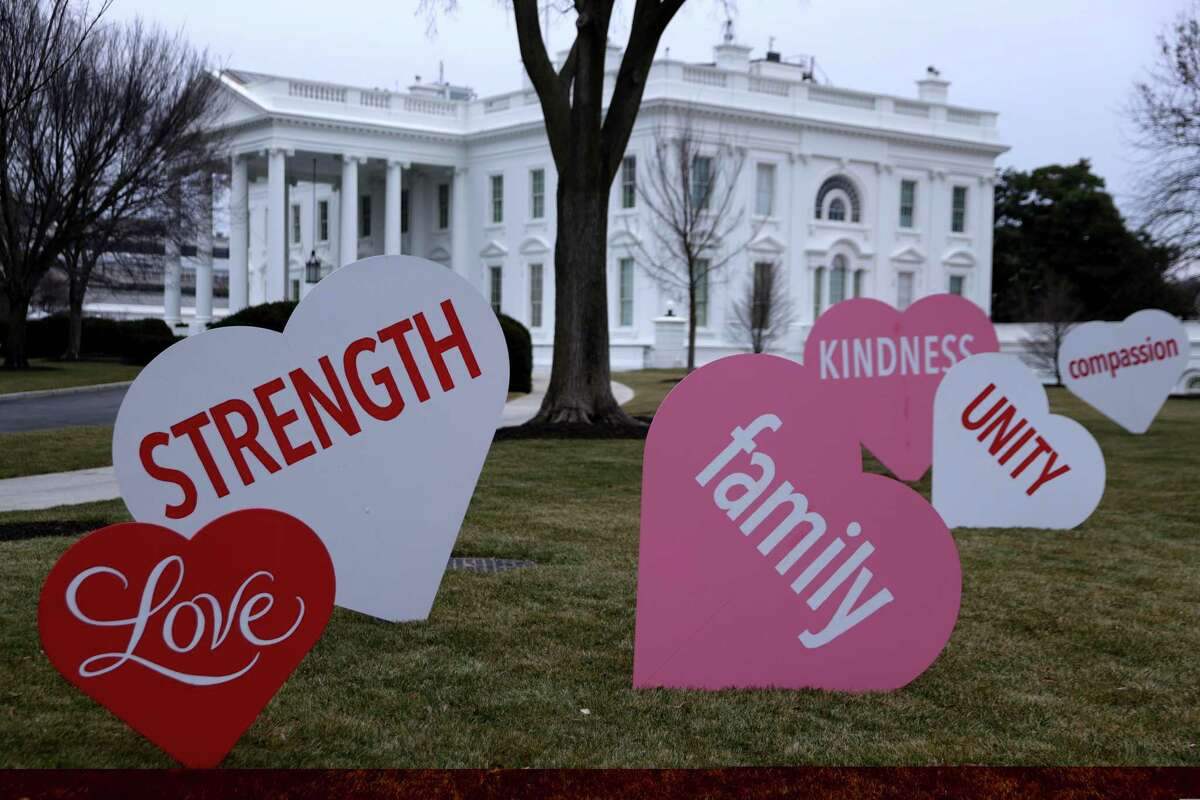 Heart-shaped signs with Valentine's Day messages are on display on the North Lawn of the White House on Friday, Feb. 12. The office of first lady Jill Biden set up the messages to mark Valentine's Day. According to a media release, Valentine's Day has always been one of her favorite holidays.