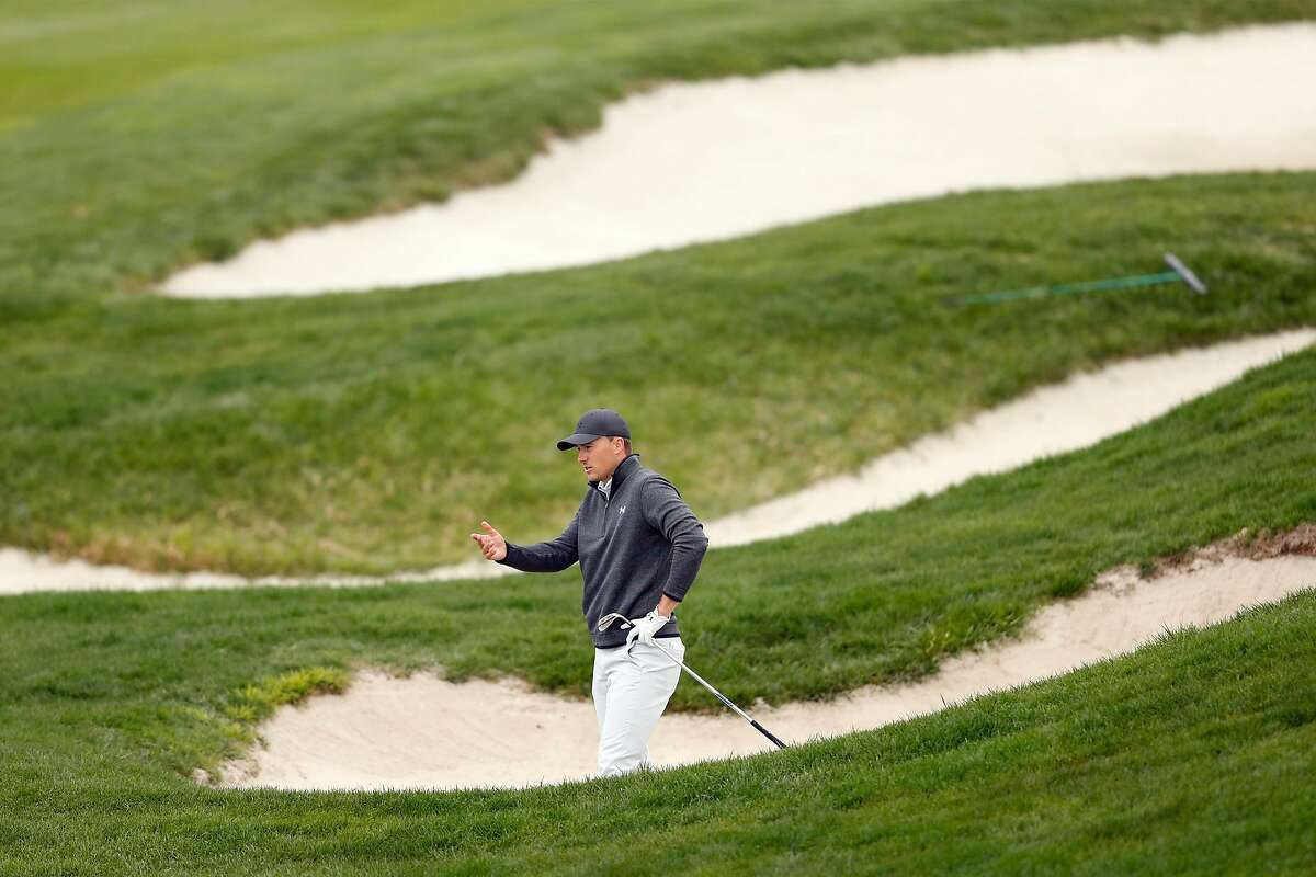 Jordan Spieth reacts to being in a fairway bunker while making par on No. 6 during Sunday's final round of the AT&T Pebble Beach Pro-Am.