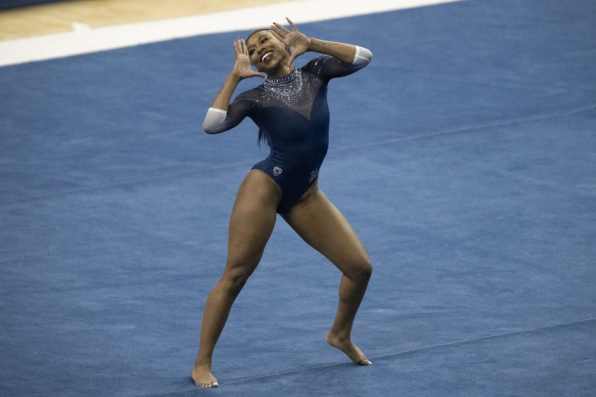 """UCLA's Nia Dennis has a floor exercise routine, dubbed """"The Culture,"""" that mashes up Kendrick Lamar and Tupac Shakur."""