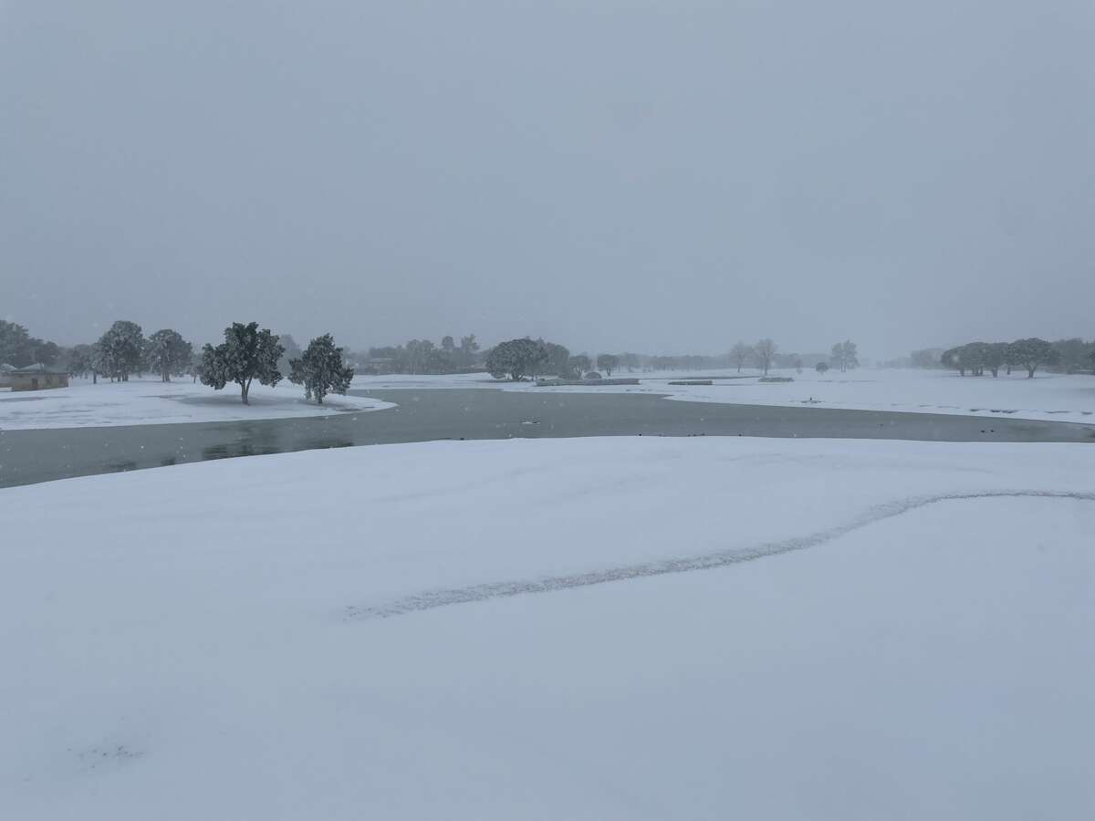 Snow accumulation is seen on February 14, 2021, in Midland.