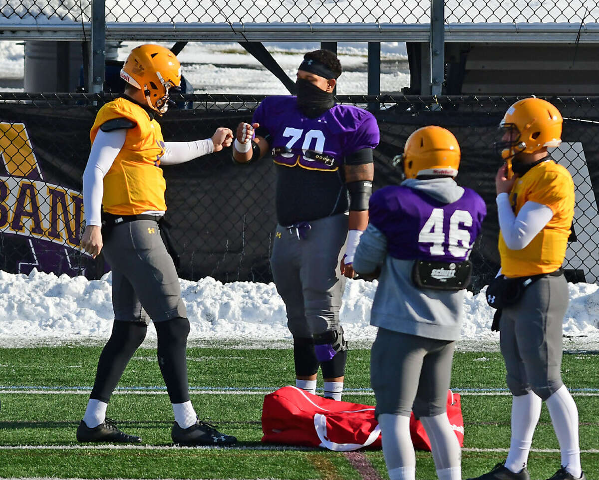 University at Albany offensive lineman Kobe Thomas (70) leads a unit that hopes to give quarterback Jeff Undercuffler, left, plenty of protection this season. (Lori Van Buren/Times Union)