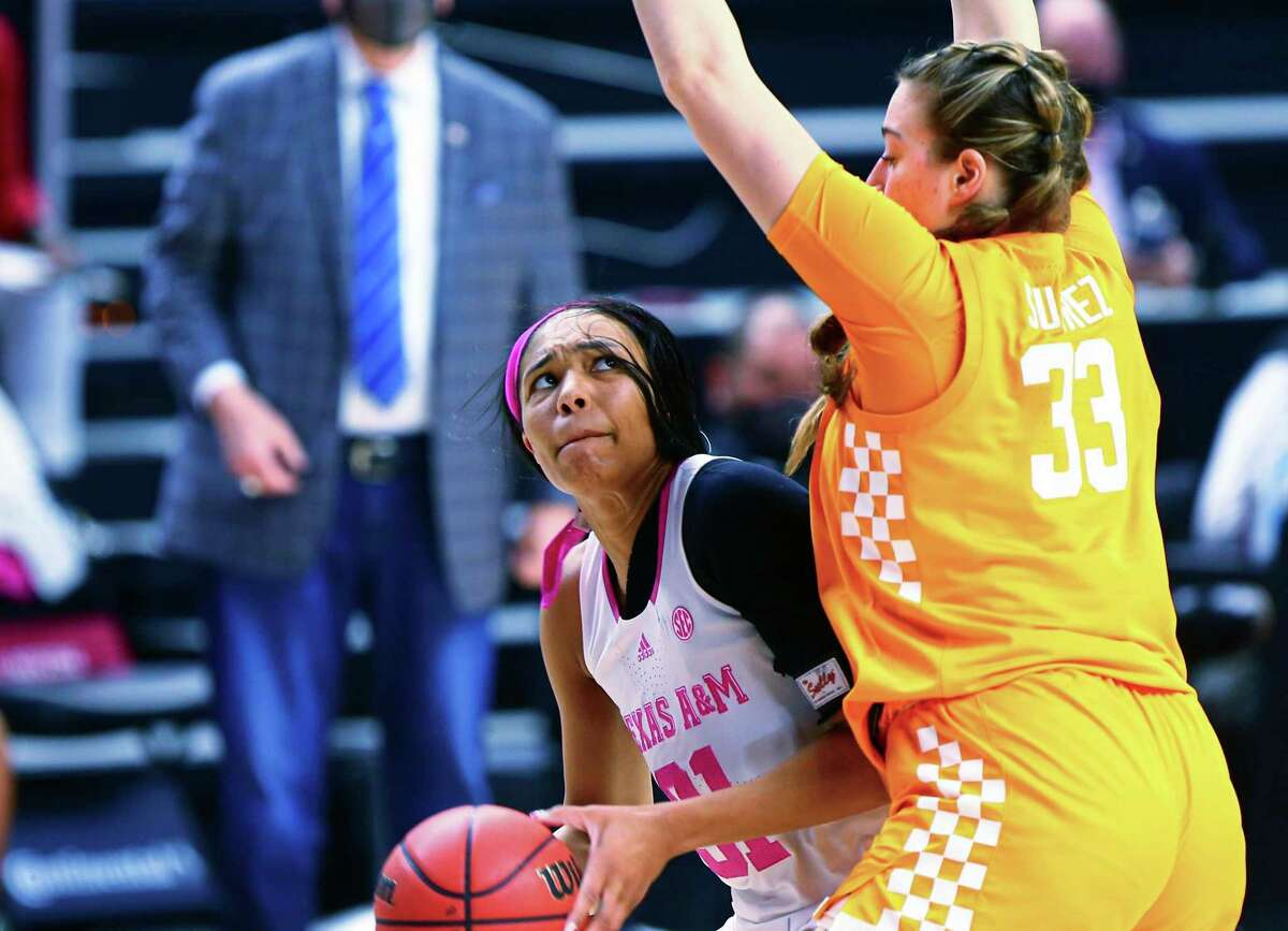 Texas A&M's N'dea Jones (31) looks for a shot over Tennessee's Marta Suárez (33) during an NCAA college basketball game at Reed Arena in College Station, Texas on Sunday, Feb. 14, 2021. (Cassie Stricker/College Station Eagle via AP)