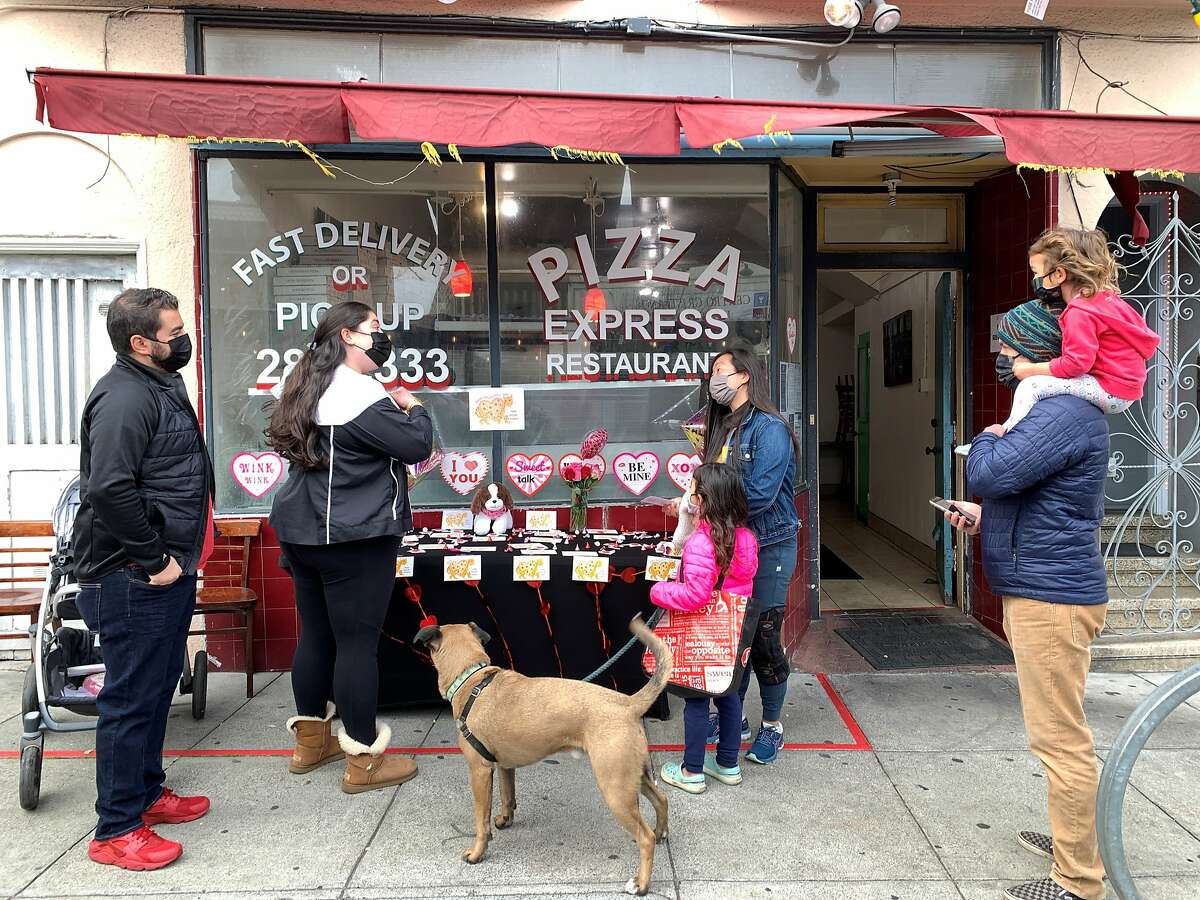 Paul Halteh and his wife, Lizzy Lama Halteh, give out pizza kits in Bernal Heights for Valentine's Day.